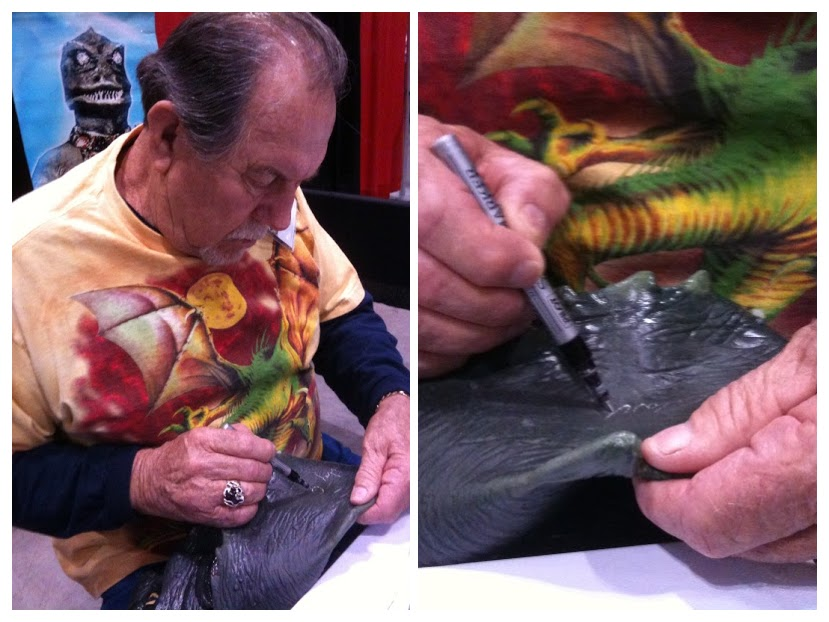 Bobby Clark, the actor who played the Gorn in the Star Trek episode Arena, signing the mask with a silver marker.