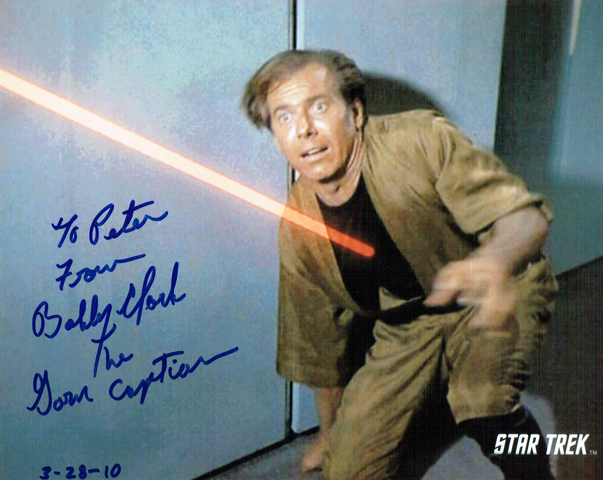 An 8x10 image from the Star Trek episode Mirror Mirror, showing Bobby Clark being hit by a phaser beam, and signed by Clark.