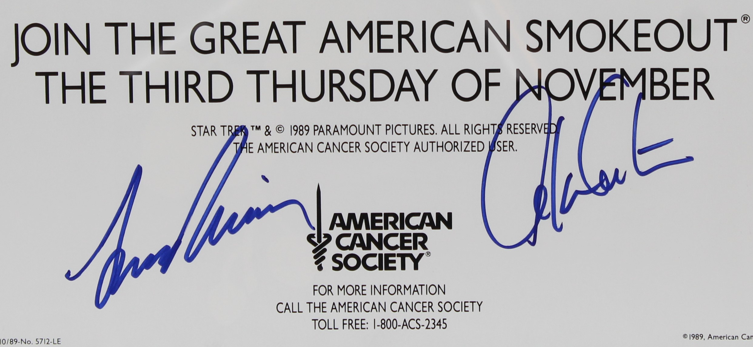 A close-up of the Leonard Nimoy and William Shatner autographs on the poster.