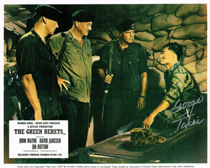 Lobby card for The Green Berets, featuring George Takei and John Wayne and two others in army uniforms, signed by George Takei
