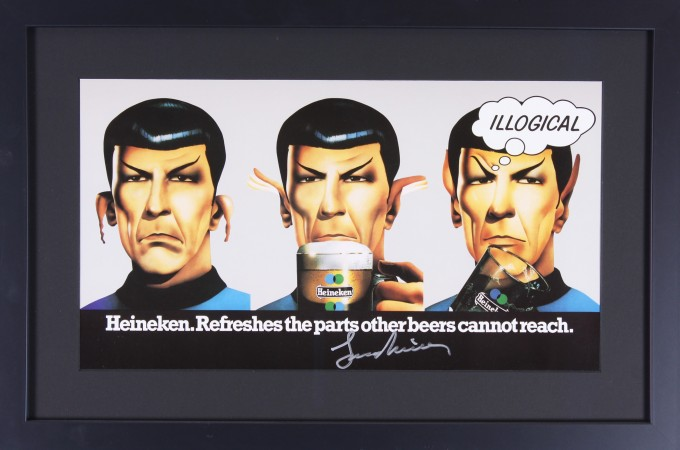 "Poster showing three illustrations of Star Trek's Mr. Spock. In the left image his ears droop, in the middle his ears are partially standing and he is about to drink from a Heineken mug, and on the right his ears are standing straight and a thought balloon reads ""Illogical."" It is signed by Leonard Nimoy."