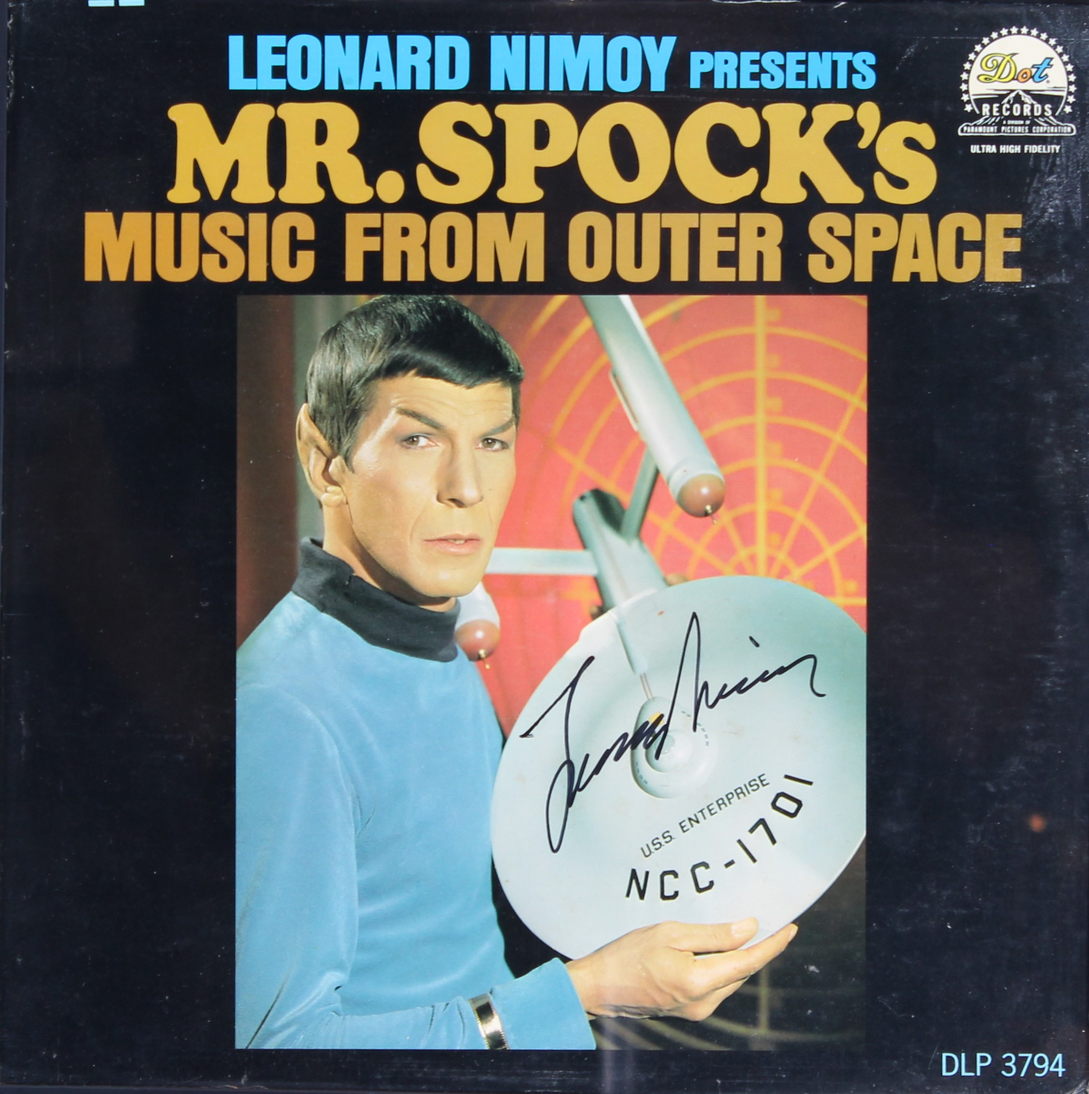 The cover of the LP record Mr. Spock's Music from Outer Space, showing Spock holding the three-foot model of the Enterprise. It is signed by Leonard Nimoy.