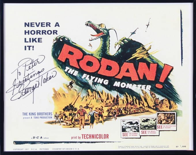 Lobby card for the Japanese science-fiction movie Rodan, signed by George Takei to Peter. In the image,  people flee from a large winged monster.