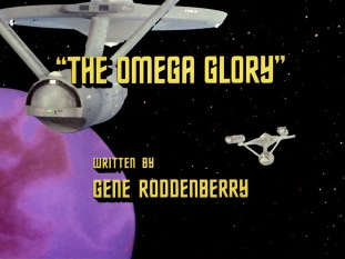 The TV title card for The Omega Glory, showing it was written by Gene Roddenberry and with images of the starships Enterprise and Exeter