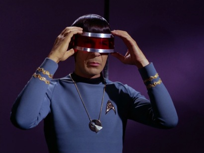 A scene from the Star Trek episode Is There in Truth No Beauty?, showing Spock wearing the Vulcan IDIC medallion.