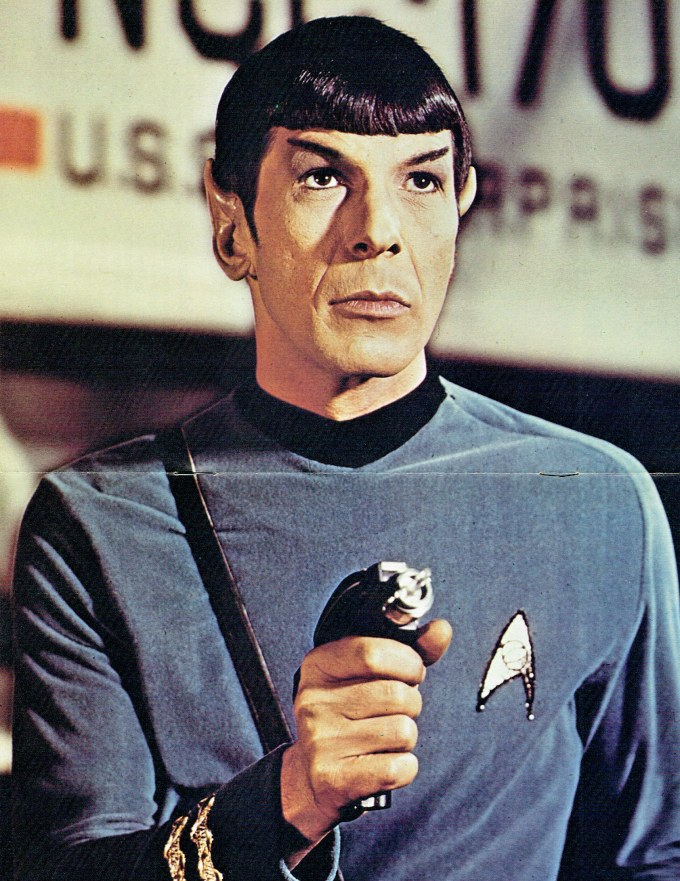 The centre poster that came with the sticker book. It is a publicity shot of Spock standing in front of the Galileo shuttlecraft, holding a phaser.