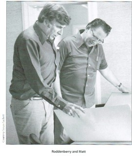 A photo of Gene Roddenberry and Matt Jefferies, showing them standing and reviewing art work