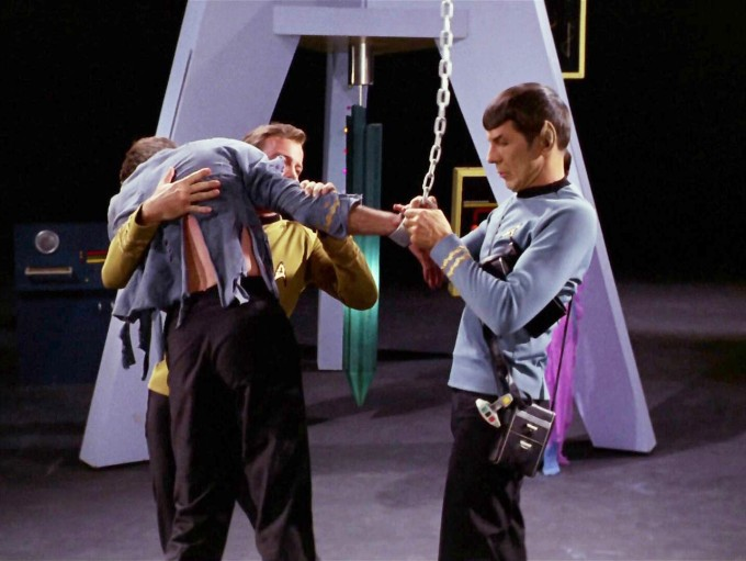 A scene from the Star Trek episode The Empath. Kirk and Spock free McCooy from the chains that had held him.
