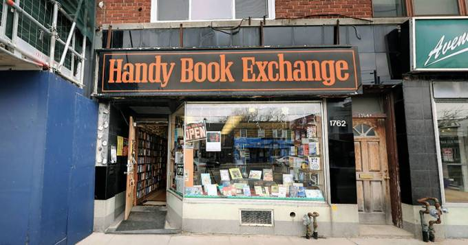 A photo of the outside of the Handy Book Exchange in Toronto, showing some renovation work being done beside the store