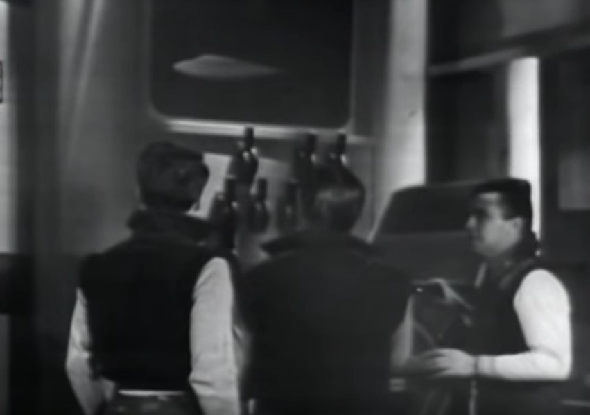 A screen cap from the TV show Space Command, showing James Doohan and two other actors on the bridge.