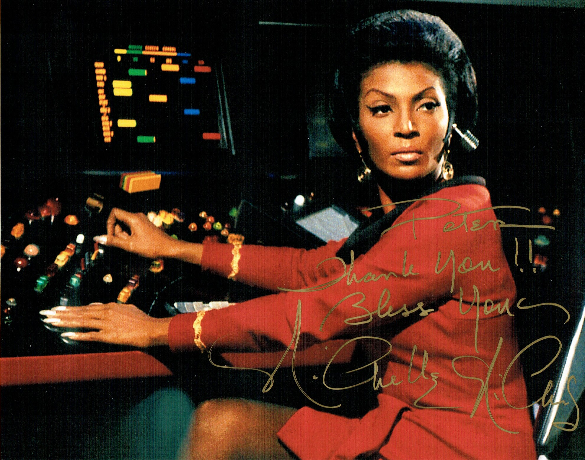 An autographed photo of Nichelle Nichols as Uhura, on the bridge of the Enterprise