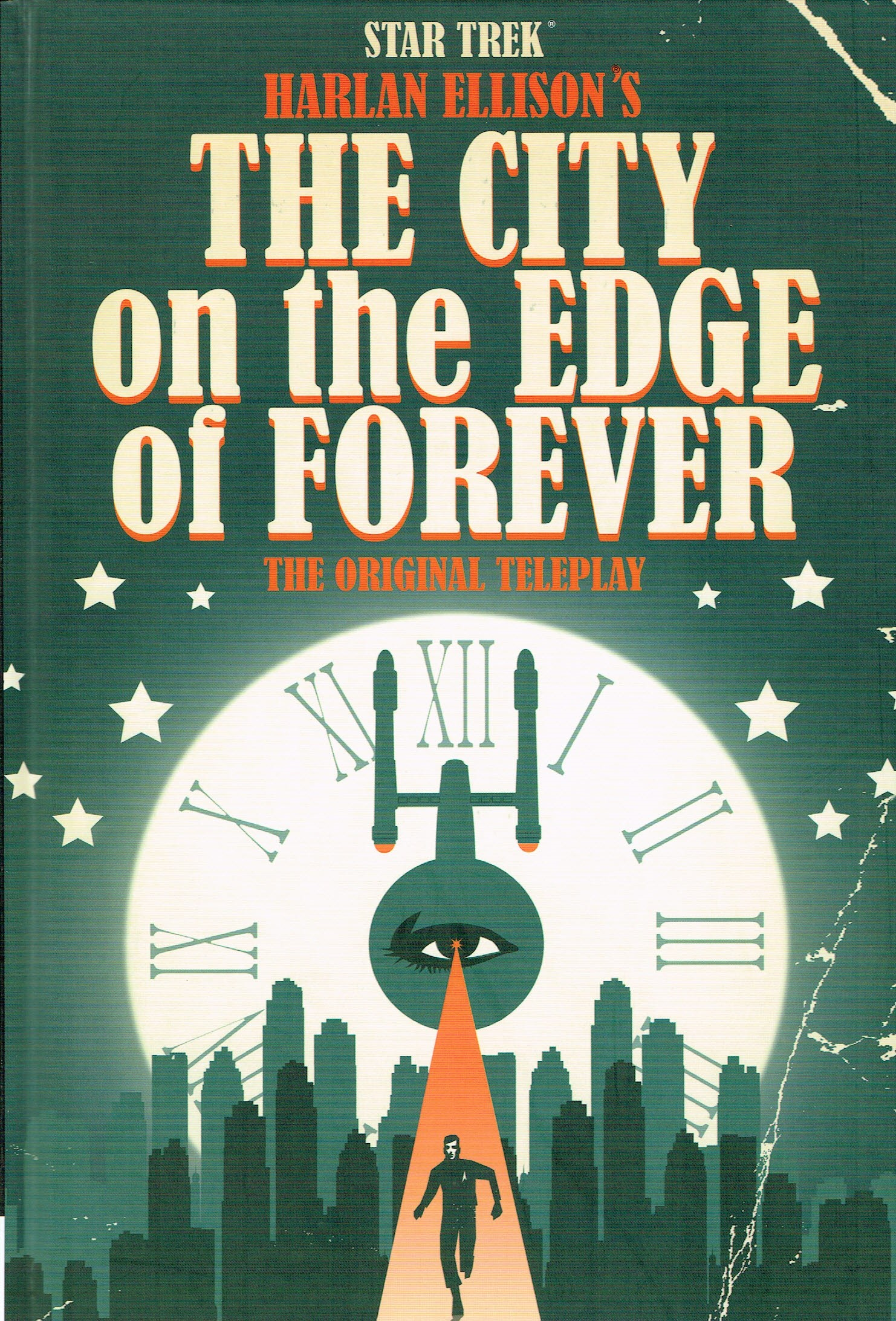 The cover of IDW's The City on the Edge of Forever graphic novel, depicting an illustration of the Enteprise, a clocl and the running figure of Kirk.