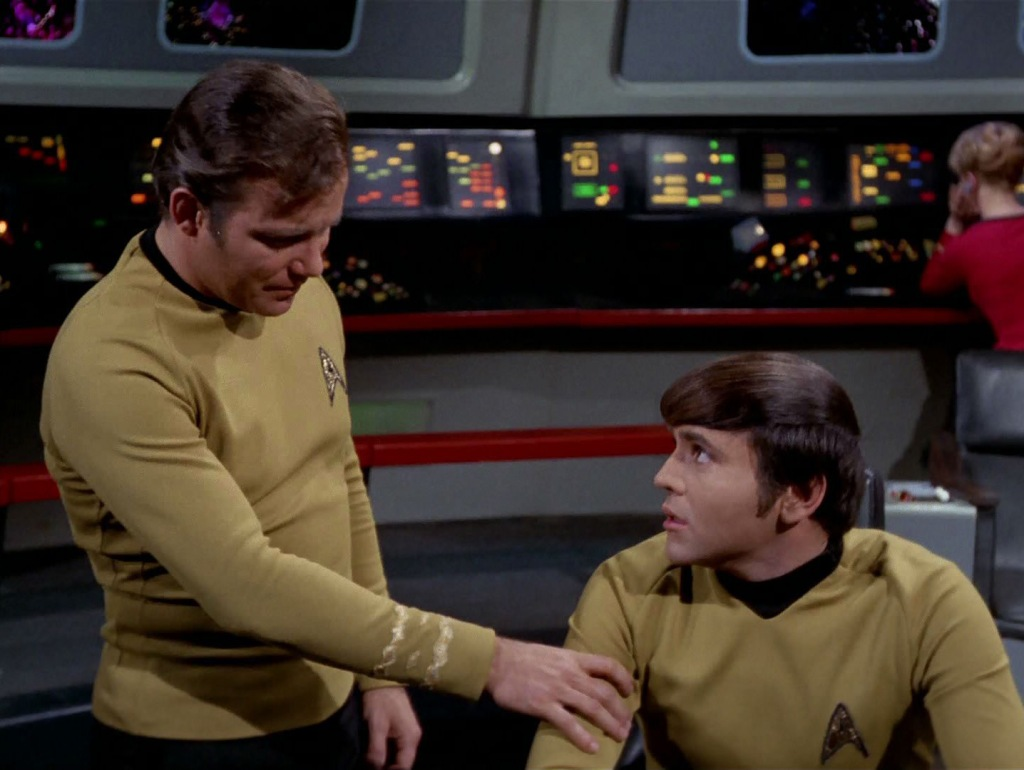On the bridge of the starship, Captain Kirk and Ensign Chekov have a conversation about Chekov's feelings for Irina