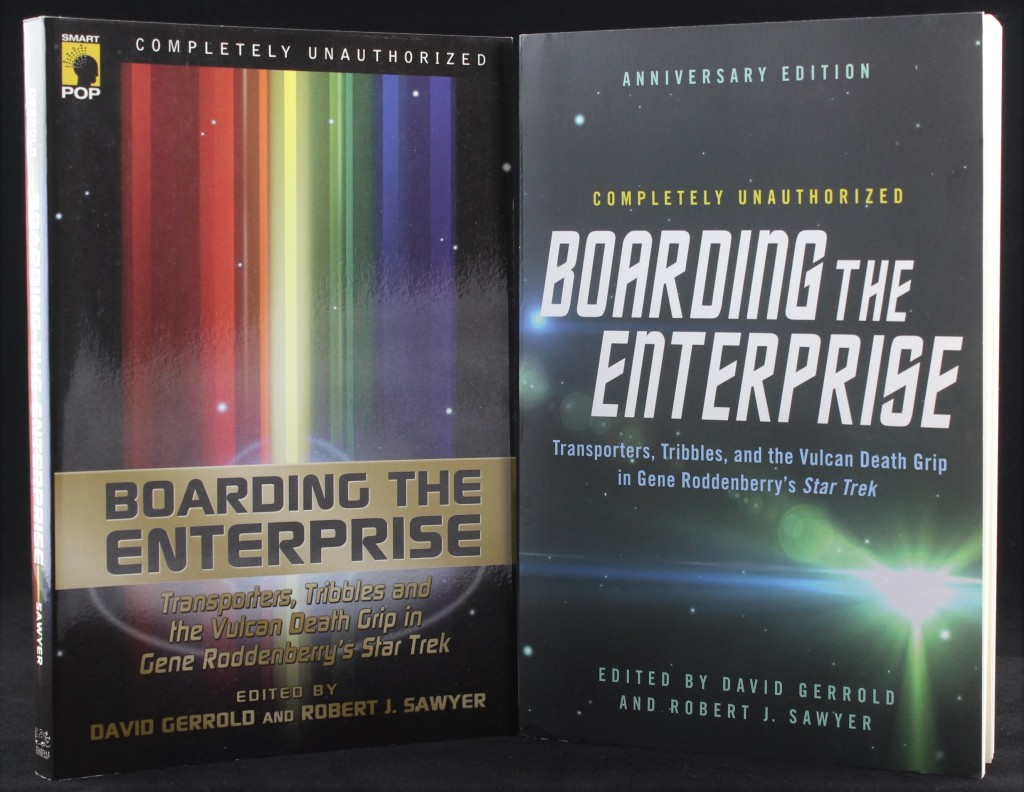 A photo showing the two editions of Boarding the Enterprise: the original and the 50th anniversary reissue. The covers are text-based, with no images.
