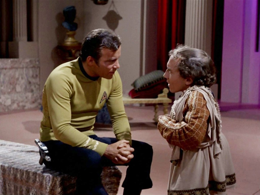 A screencap from the Star Trek episode Plato's Stepchildren, in which Captain Kirk is speaking with Alexander, a character and an actor who is a little person, and who's stature is germane to the episode.