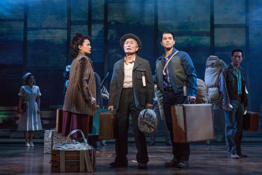 A photo of three cast members of the Broadway play Allegiance, with George Takei in the middle.