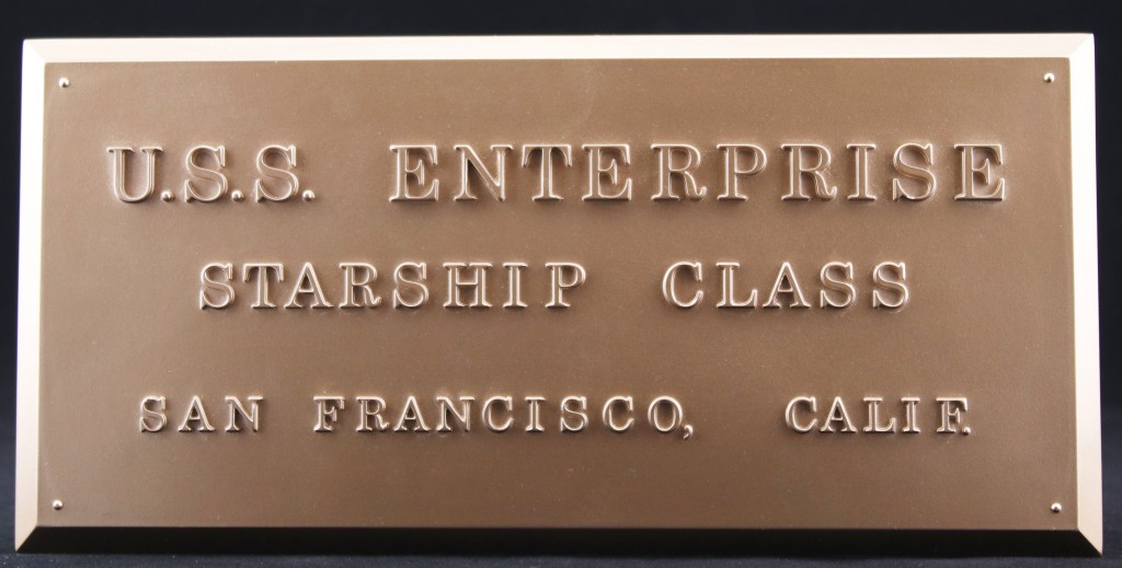 The Eaglemoss dedication plaque replica. It reads: USS Enterprise, Starship Class, San Francisco, Calif.