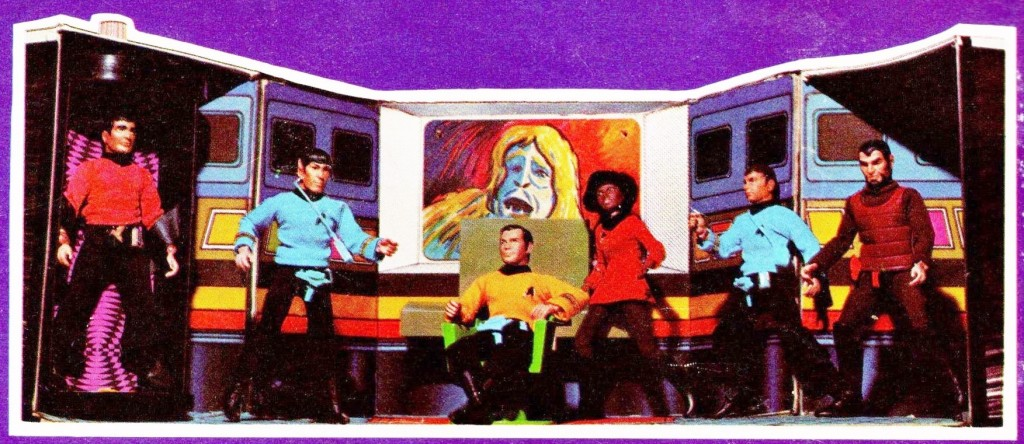 A photo of the Star Trek Enterprise Playset taken from the packaging of the Mego figures. It shows six figures on the bridge.