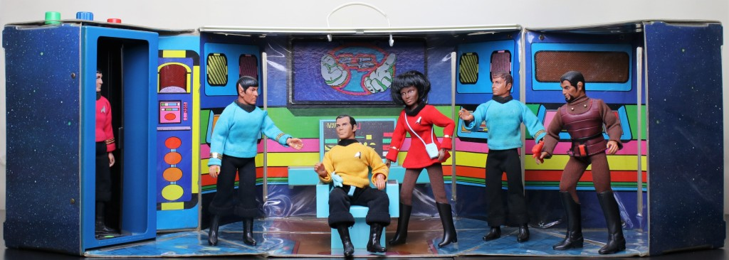An overall photo of the Star Trek Mego Enterprise playset, featuring (left to right) Scotty, Spock, Kirk, Uhura, McCoy and the Klingon.