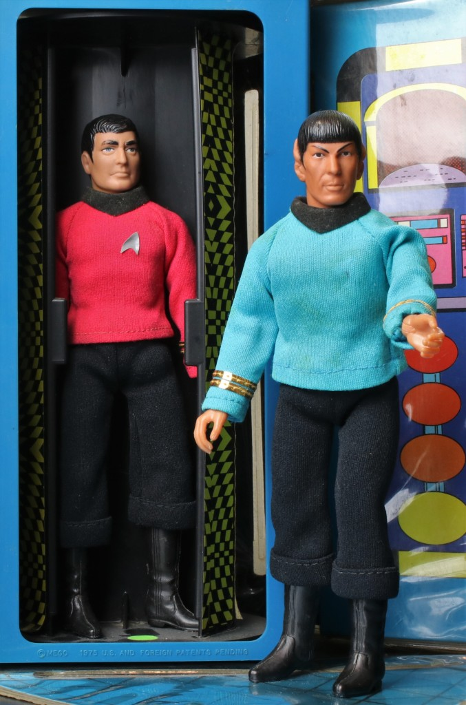 Scotty in the transporter console with Spock standing nearby, on the Star Trek Mego Enterprise playset.