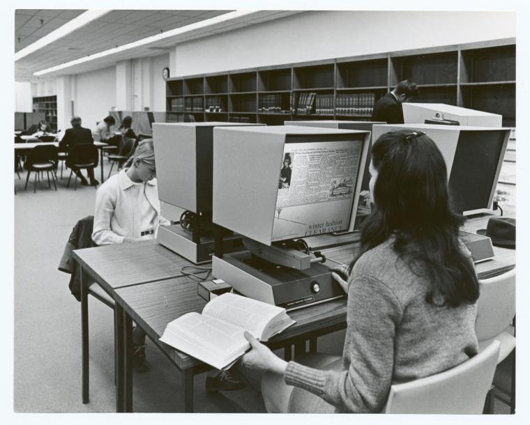 An image from the Internet of people using microfilm readers in the '80s.