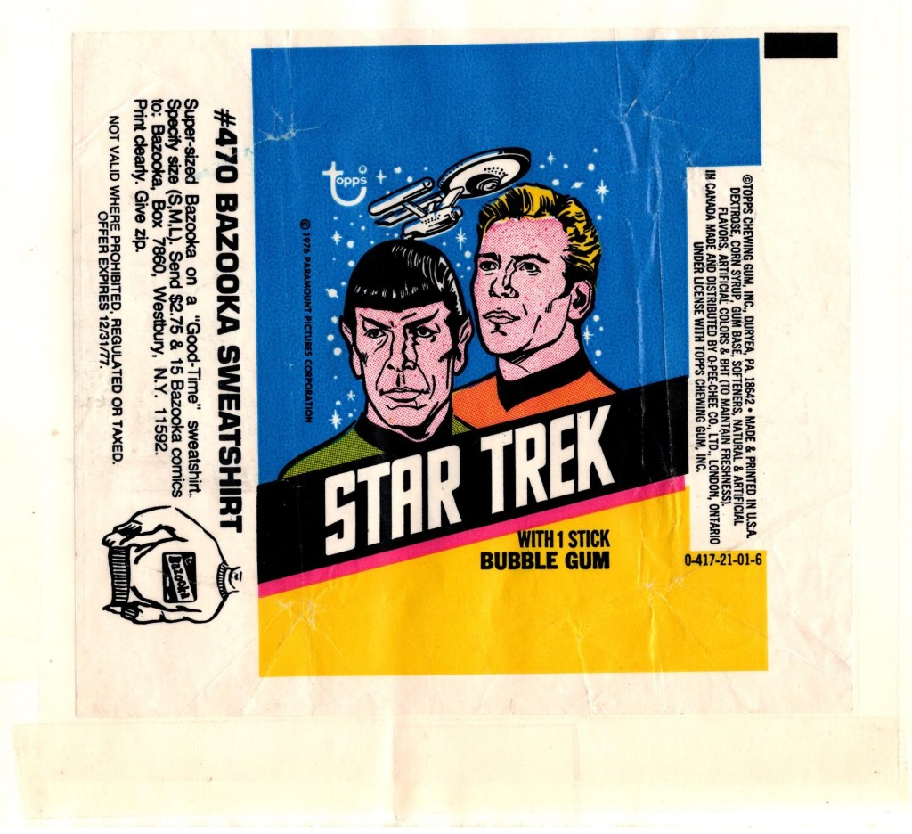 A really nice wrapper from the 1976 Star Trek card set, laid flat and covered with a taped piece of plastic.